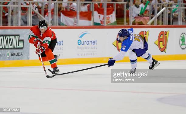 Krisztian Nagy of Hungary leaves Nikita Mikhailis of Kazakhstan behind during the 2018 IIHF Ice Hockey World Championship Division I Group A match...