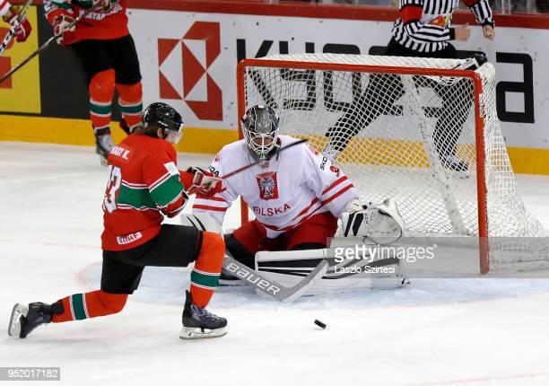 Krisztian Nagy of Hungary tries to shoot before goalie Przemyslaw Odrobny of Poland during the 2018 IIHF Ice Hockey World Championship Division I...