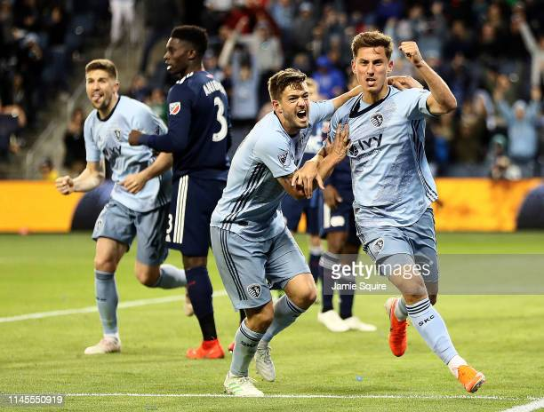 Krisztian Nemeth of Sporting Kansas City celebrates with Kelyn Rowe after scoring during the second half of the game against the New England...