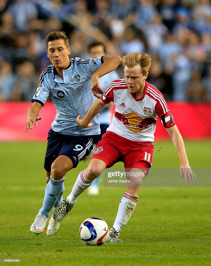 Krisztian Nemeth #9 of Sporting KC and Dax McCarty #11 of New York Red Bulls compete for the ball during the game at Sporting Park on March 8, 2015 in Kansas City, Kansas.