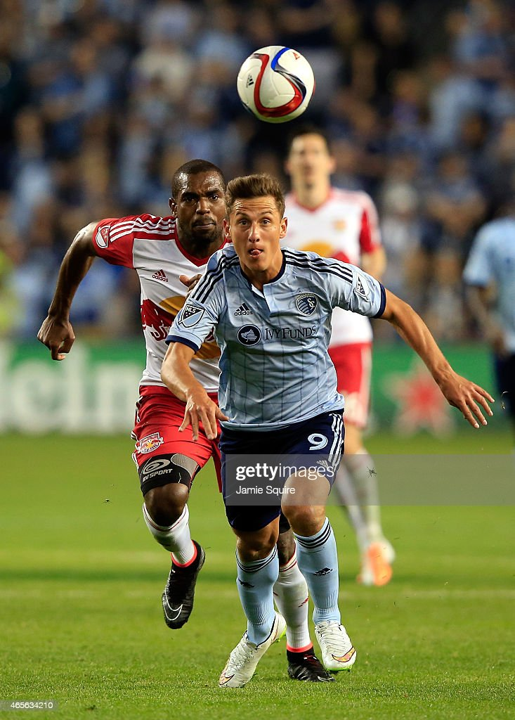 Krisztian Nemeth #9 of Sporting KC and Ronald Zubar #23 of New York Red Bulls chase the ball during the game at Sporting Park on March 8, 2015 in Kansas City, Kansas.