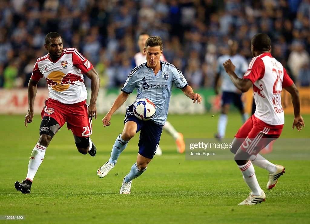 Krisztian Nemeth #9 of Sporting KC controls the ball as Ronald Zubar #23 and Chris Duvall #25 of New York Red Bulls defend during the game at Sporting Park on March 8, 2015 in Kansas City, Kansas.