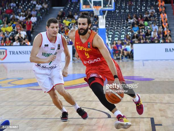Krisztian Wittmann of Hungary vies with Ricky Rubio of Spain during Group C of the FIBA Eurobasket 2017 mens basketball match between Hungary and...