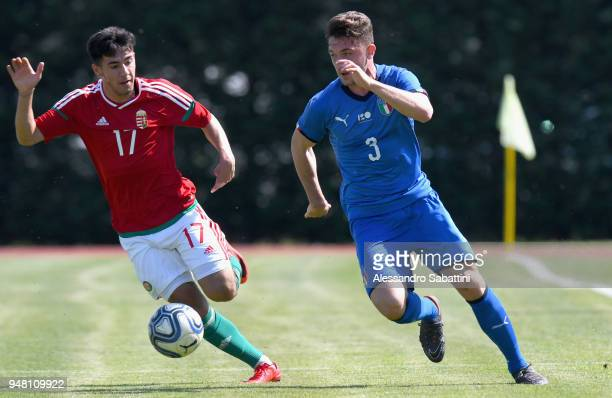 Krisztofer Szereto of Hungary U18 competes for the ball whit Niccolò Corrado of Italy U18 during the U18 match between Italy and Hungary on April 18...