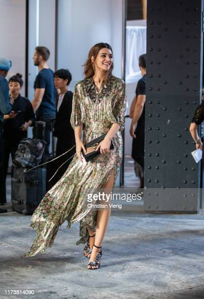 Kriti Sanon is seen wearing golden dress with floral print outside Coach during New York Fashion Week September 2019 on September 10 2019 in New York...