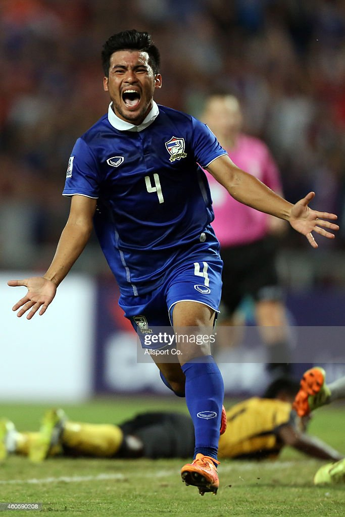 Kroekrit Thawikan of Thailand reels away in delight fter scoring the 2nd goal against Malaysia during the 2014 AFF Suzuki Cup final 1st leg match between Thailand and Malaysia at Rajamangala National Stadium on December 17, 2014 in Bangkok, Thailand.