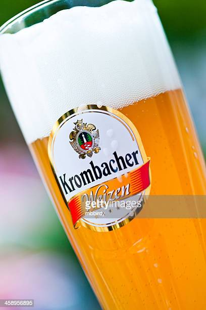 krombacher weizen (wheat) beer - weizen stock pictures, royalty-free photos & images