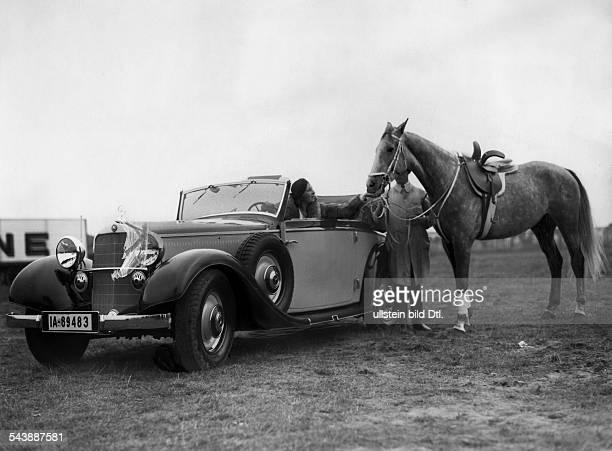 Krone Frieda Performer Germany* sitting in her Mercedes and stroking her new school horse 'Eintaenzer' 1933 Photographer Carl Fernstaedt Published by...