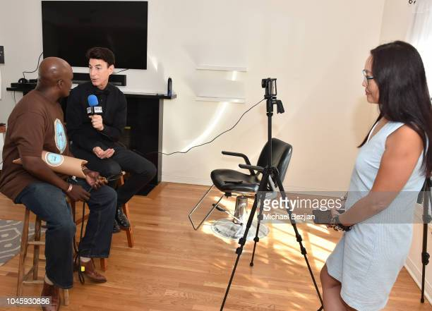 Kronez founder John Glanton is interviewed by BJ Korros of Shout Out For A Cause with Joyce Chow behind camera at Mr Jack Visits TAP The Artists...