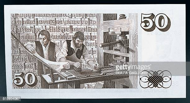 50 kronur banknote reverse printers at work on a printing press in 16th century Iceland 20th century
