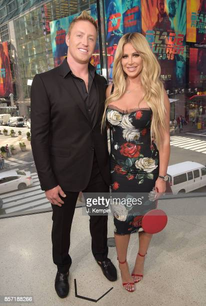 Kroy Biermann and television personality Kim Zolciak visit Extra at HM Times Square on October 3 2017 in New York City