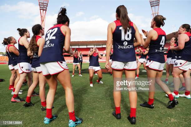 Krstel Petrevski of the Demons and team mates celebrate victory after the AFLW Semi Final match between the Greater Western Sydney Giants and the...