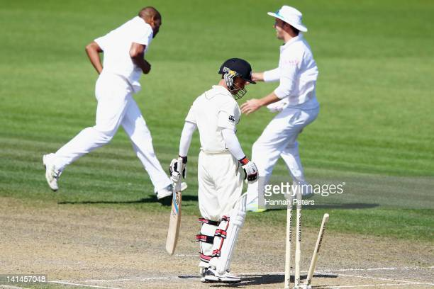Kruger van Wyk of New Zealand looks down at the broken wickets after being bowled out by Vernon Philander of South Africa during day three of the...