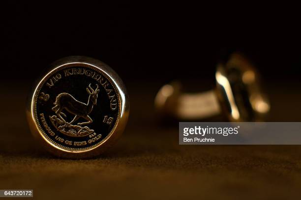 Krugerrand cuff links with the value of 1090 GDP are displayed at Sharps Pixley Bullion Brokers on December 15 2015 in London England The brand...