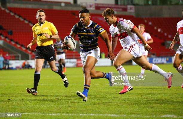 Kruise Leeming of Leeds Rhinos breaks through to score a try during the Coral Challenge Cup Quarter Final match between Leeds Rhinos of Hull Kingston...
