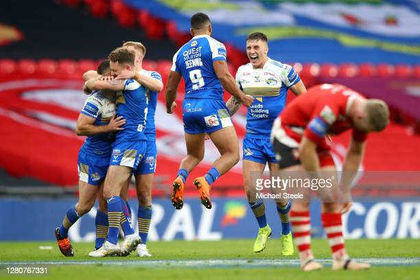 Kruise Leeming of Leeds Rhinos celebrates victory with teammates at full-time during the Coral Challenge Cup Final match between Leeds Rhinos and...