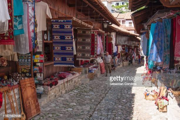 kruja, historical site of albania, tourist attraction and souvenir market, travel in eastern european culture, balkans country. - krujë stockfoto's en -beelden