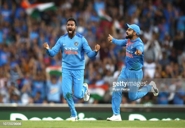 Krunal Pandya of india celebrates after taking the wicket of Ben McDermott of Australia during the International Twenty20 match between Australia and...