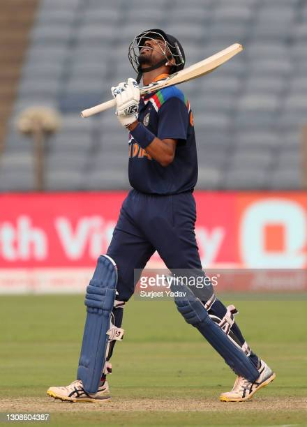 Krunal Pandya of India celebrates reaching his half century during 1st One Day International between India and England at MCA Stadium on March 23,...