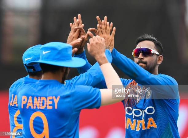 Krunal Pandya of India celebrates the dismissal of Nicholas Pooran of West Indies during the 2nd T20i match between West Indies and India at Central...