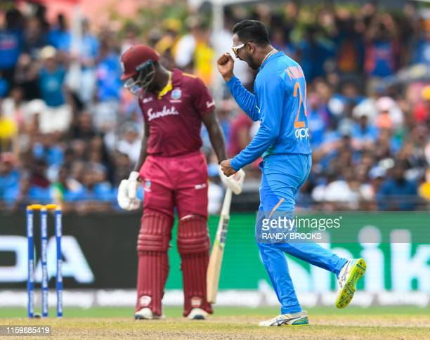 Krunal Pandya of India celebrates the dismissal of Rovman Powell of West Indies during the 2nd T20i match between West Indies and India at Central...