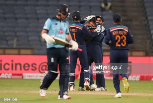 Krunal Pandya of India celebrates with captain Virat Kohli after dismissing Sam Curran of England during 1st One Day International between India and...