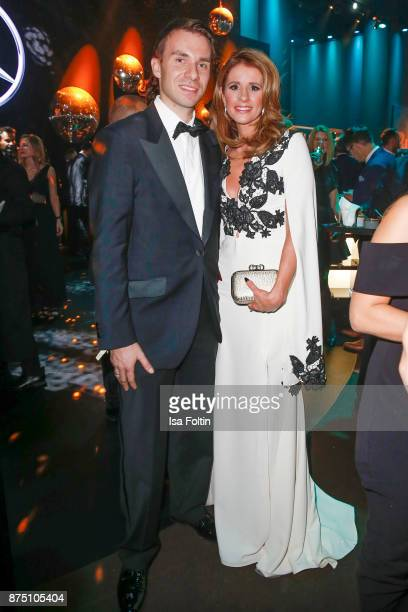 Kryolan managing director Dominik Langer and Viviane Geppert pose at the Bambi Awards 2017 party at Atrium Tower on November 16 2017 in Berlin Germany