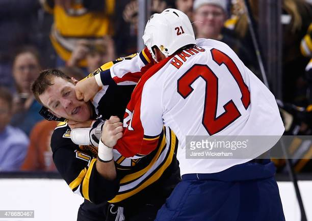 Krys Barch of the Florida Panthers fights Shawn Thornton of the Boston Bruins in the second period during the game at TD Garden on March 4 2014 in...