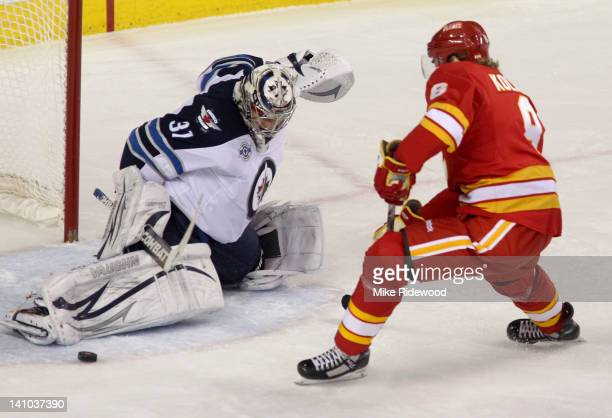 Krys Kolanos of the Calgary Flames is stopped by Ondrej Pavelec of the Winnipeg Jets in thirdperiod NHL action on March 9 2012 at the Scotiabank...