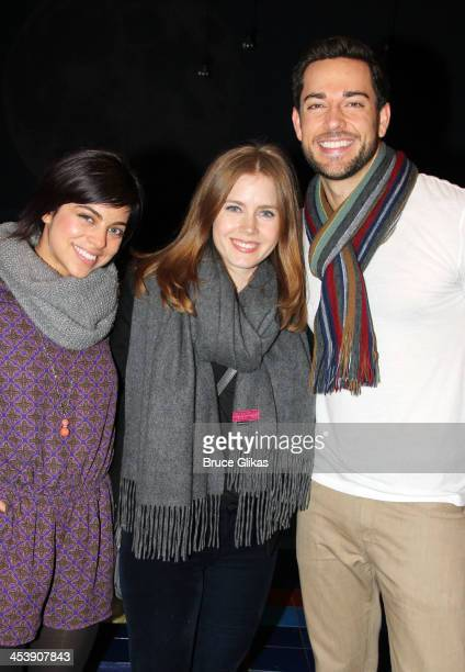 Krysta Rodriguez Amy Adams and Zachary Levi pose backstage at 'First Date' on Broadway at The Longacre Theater on December 5 2013 in New York City