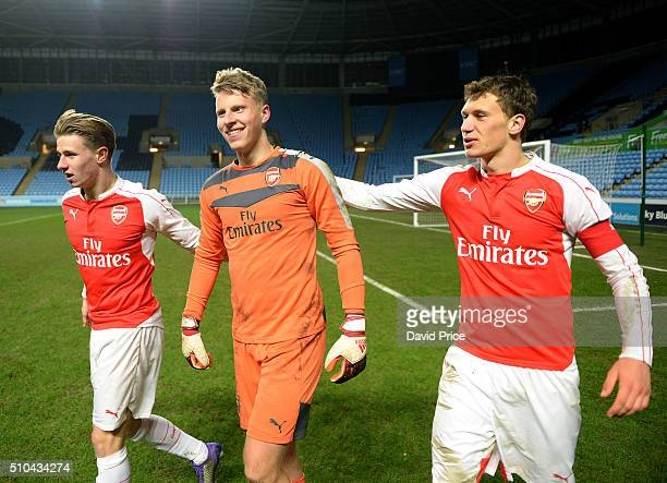 Krystain Bielik and Ben Sheaf congratulate Hugo Keto after the penalty shoot out during the match between Coventry City v Arsenal in the FA Youth Cup...