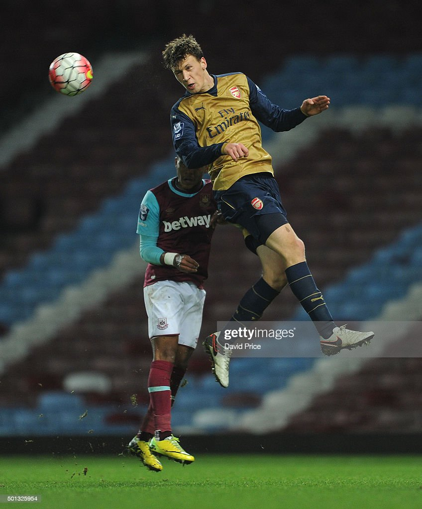 Krystain Bielik of Arsenal heads the ball under pressure from Djair Parfitt-Williams of West Ham during match between West Ham United U21 and Arsenal U21 at Boleyn Ground on December 14, 2015 in London, England.