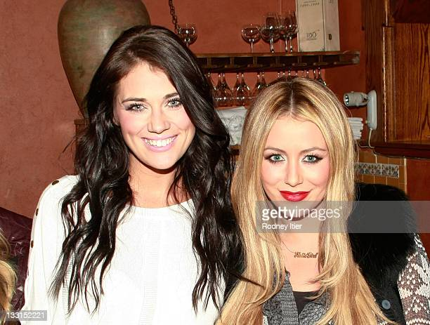 Krystal Bronson and TV personality Aubrey O'Day pose at the House Of Hype LIVEstyle Lounge on January 21 2011 in Park City Utah