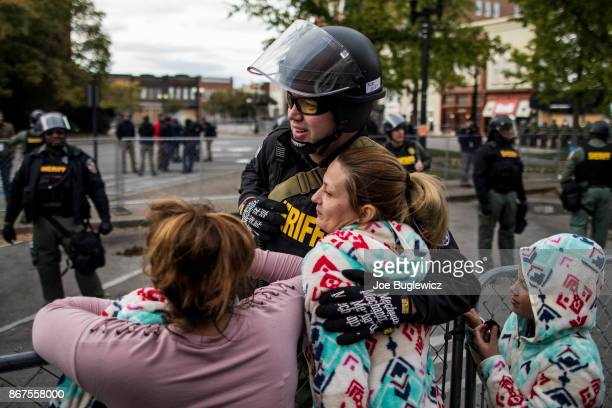 Krystal Dunnaway of Nashville hugs an officer after a White Lives Matter rally on October 28 2017 in Murfreesboro Tennessee Tennessee Gov Bill Haslam...