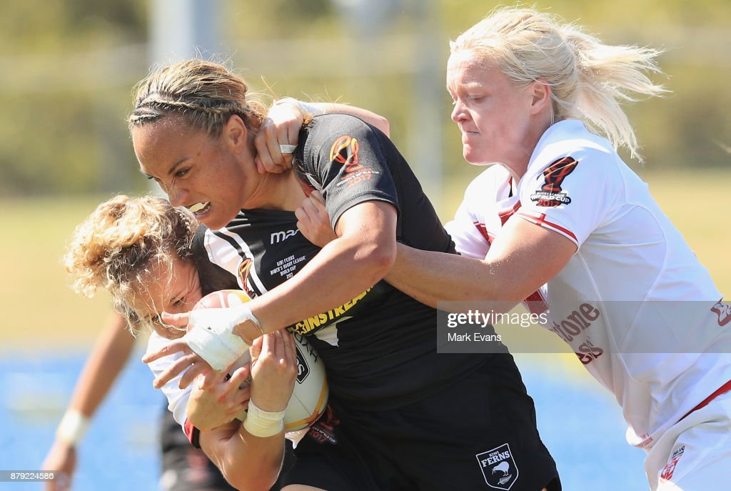 Krystal Rota of New Zealand tackled by Beth Southgate of Englandduring the 2017 Rugby League World Cup Semi Final match between New Zealand and England at Southern Cross Group Stadium on November 26, 2017 in Sydney, Australia.