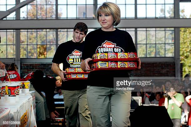 Krystal staff bring the competition burgers to the stage at the Krystal Square Off III World Hamburger Eating Championship Chatanooga Tennessee USA  ...