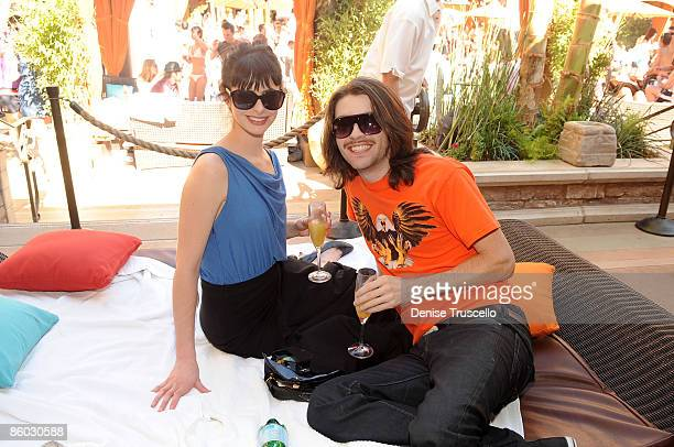 Krysten Ritter and Scott Culver attend TAO Beach at The Venetian Hotel and Casino on April 18 2009 in Las Vegas Nevada