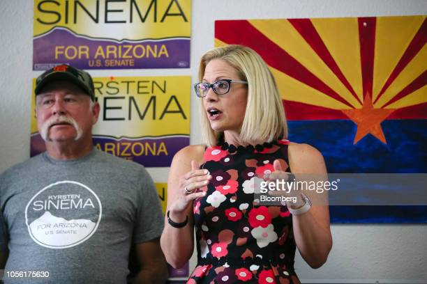 Krysten Sinema Democratic US Senate candidate from Arizona right speaks during a campaign event in Phoenix Arizona US on Thursday Nov 1 2018 In...