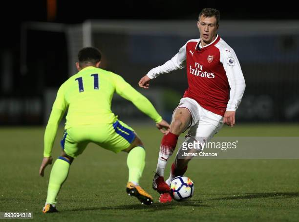 Krystian Bielik of Arsenal attempts to get past Mason Bennett of Derby during the Premier League 2 match between Arsenal and Derby County at Meadow...
