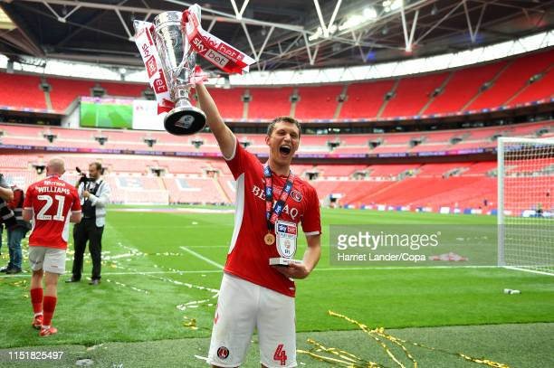 Krystian Bielik of Charlton Athletic celebrates with his Player of the Match Award and the Sky Bet League One Playoff Final Trophy following his...