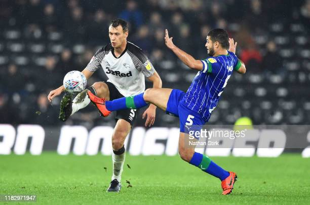 Krystian Bielik of Derby and Sam Morsy of Wigan in action during the Sky Bet Championship match between Derby County and Wigan Athletic at Pride Park...