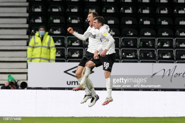 Krystian Bielik of Derby County scores a goal to make it 1-0 and celebrates with team-mate Jason Knight during the Sky Bet Championship match between...