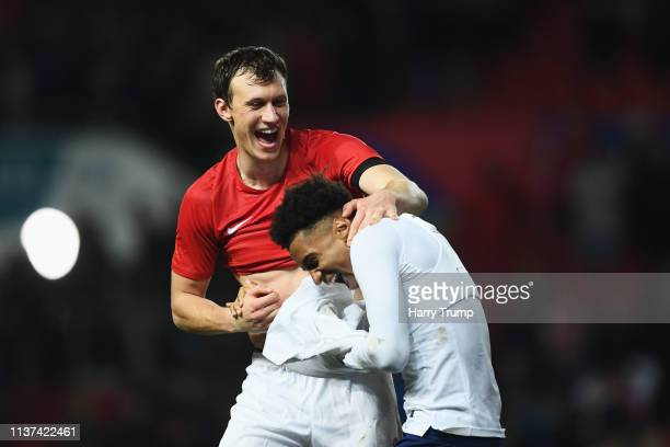 Krystian Bielik of Poland and Reiss Nelson of England share a joke after the U21 International Friendly match between England and Poland at Ashton...
