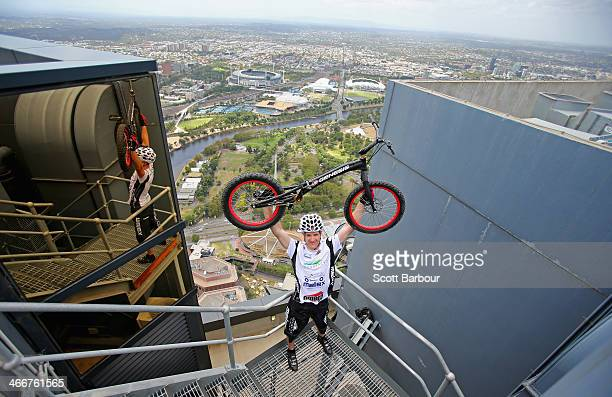 Krystian Herba a Polish extreme cyclist celebrates after jumpinhg up the steps of Eureka Tower on a bicycle as he breaks a Guinness World Record at...