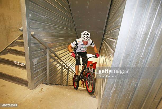 Krystian Herba a Polish extreme cyclist jumps up the steps of Eureka Tower on a bicycle as he breaks a Guinness World Record at Eureka Tower on...