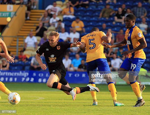 Krystian Pearce of Mansfield Town tackles Jarrod Bowen of Hull City during the preseason friendly match between Mansfield Town and Hull City at the...