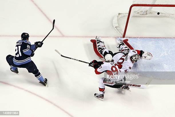 Krystofer Barch of the Florida Panthers shoots and scores a goal against goaltender Robin Lehner of the Ottawa Senators at the BankAtlantic Center on...
