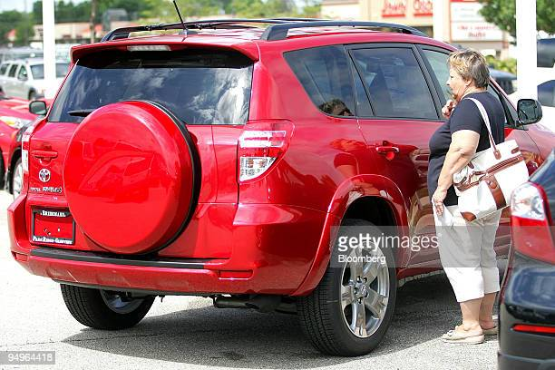 """Krystyna Gilbar looks at a new Toyota RAV4 she is considering purchasing through the """"cash for clunkers"""" program at Bredemann Toyota dealership in..."""