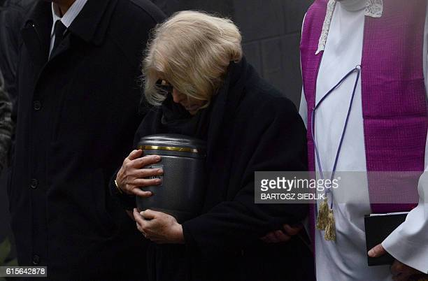 Krystyna Zachwatowicz widow of late Polish filmmaker Andrzej Wajda carries the ashes urn during the funeral ceremony in Salwator cemetery in Krakow...
