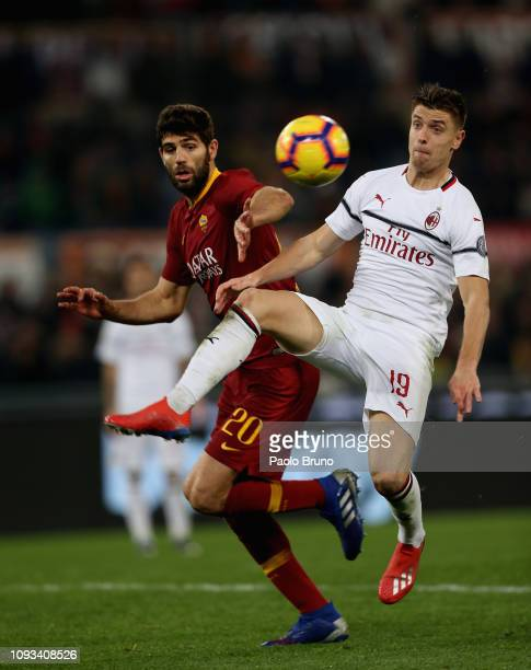 Krysztof Piatek of AC Milan competes for the ball with Federico Fazio of AS Roma during the Serie A match between AS Roma and AC Milan at Stadio...